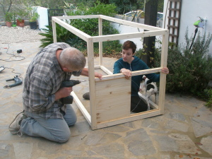 Geoff and Rosemary fit the sliding door, ably assisted by Minnow